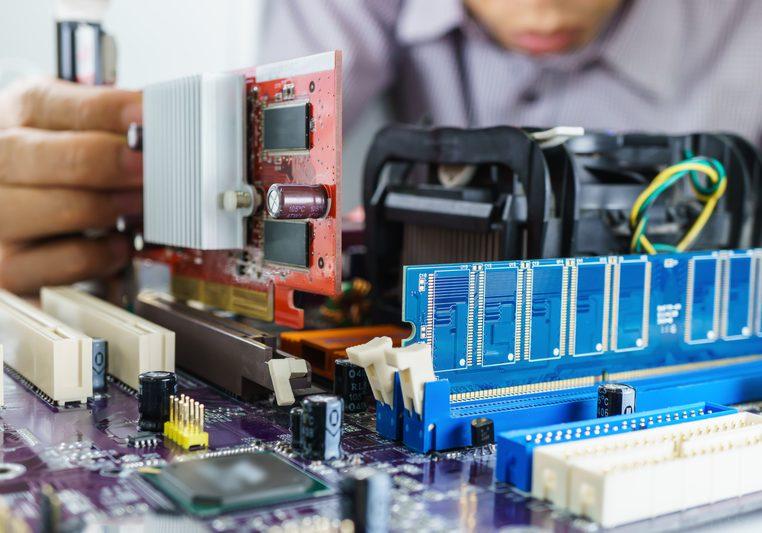 Technician's hands Installing VGA card